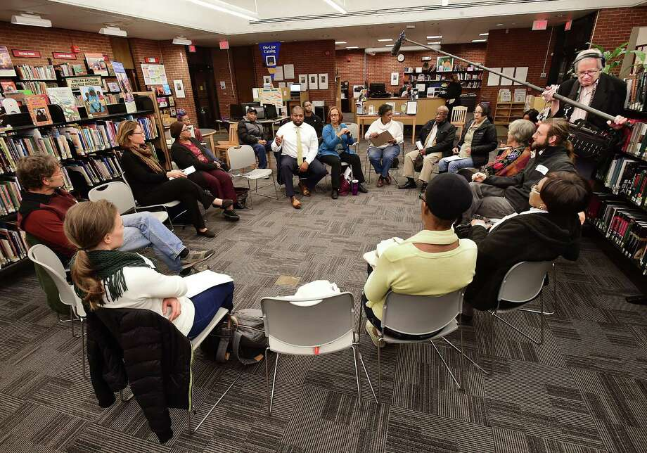 State Senator Gary Winfield (D-New Haven) addresses issues regarding rodents, housing, transportation, militarization of police, homelessness and the energy program at one of a series of community conversations in the 10th Senatorial District, Wednesday, Dec. 6, 2017, at the Stetson Branch Library at 200 Dixwell Ave. in New Haven. Photo: Catherine Avalone, Hearst Connecticut Media / New Haven Register