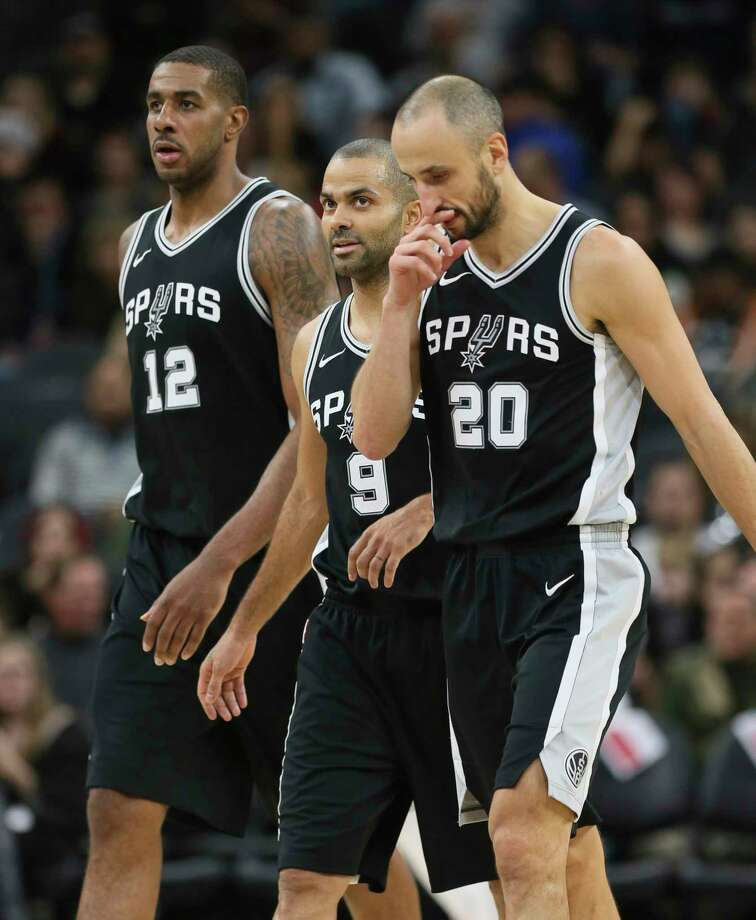 Spurs' LaMarcus Aldridge (12), Tony Parker (09) and Manu Ginobili (20) walk off the floor during a timeout against the Miami Heat at the AT&T Center on Wednesday, Dec. 6, 2017. Photo: Kin Man Hui, San Antonio Express-News / ©2017 San Antonio Express-News