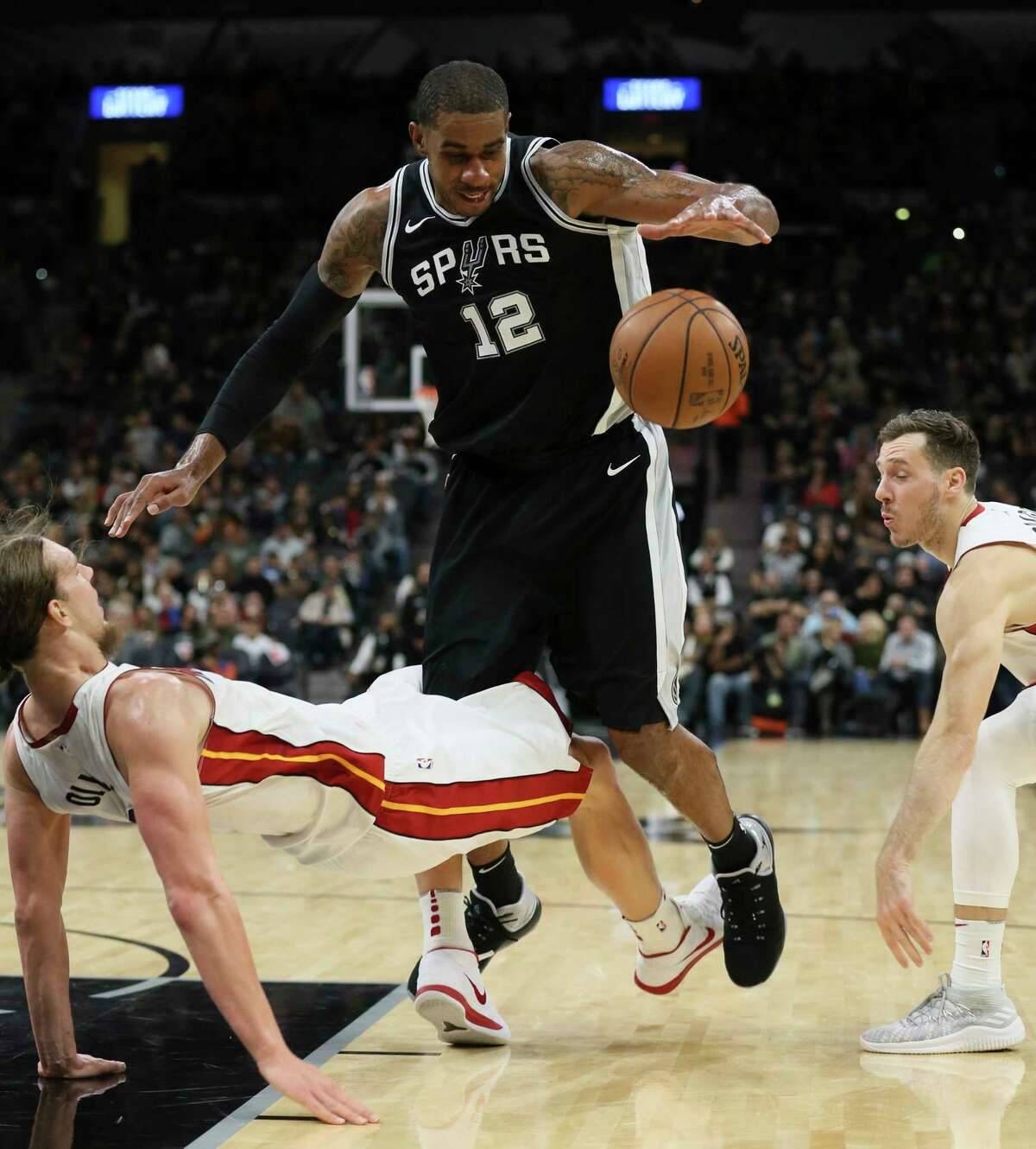 Spurs' LaMarcus Aldridge (12) collides with Miami Heat's Kelly Olynyk (09) at the AT&T Center on Wednesday, Dec. 6, 2017.