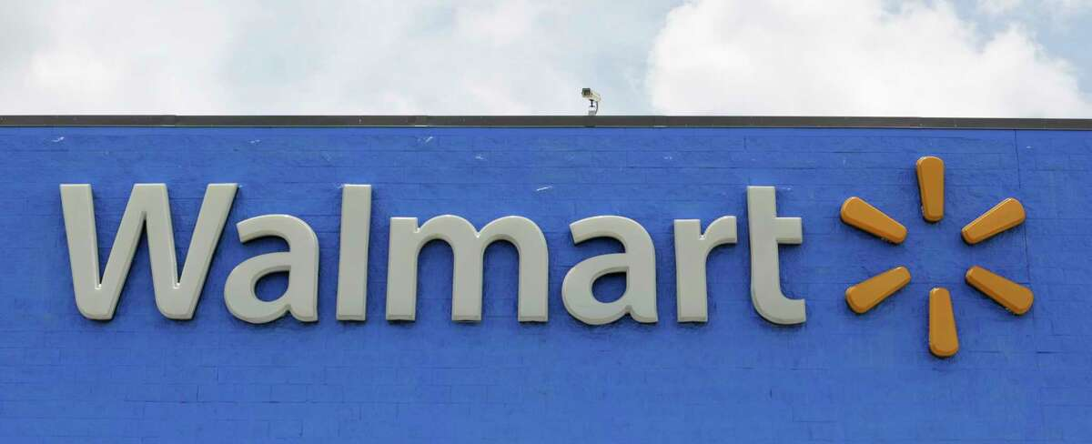 FILE - This June 1, 2017, file photo shows a Walmart store in Hialeah Gardens, Fla. Wal-Mart Stores Inc. is changing its legal name effective Feb. 1, 2018, to Walmart Inc. from Wal-Mart Stores Inc. (AP Photo/Alan Diaz, File)