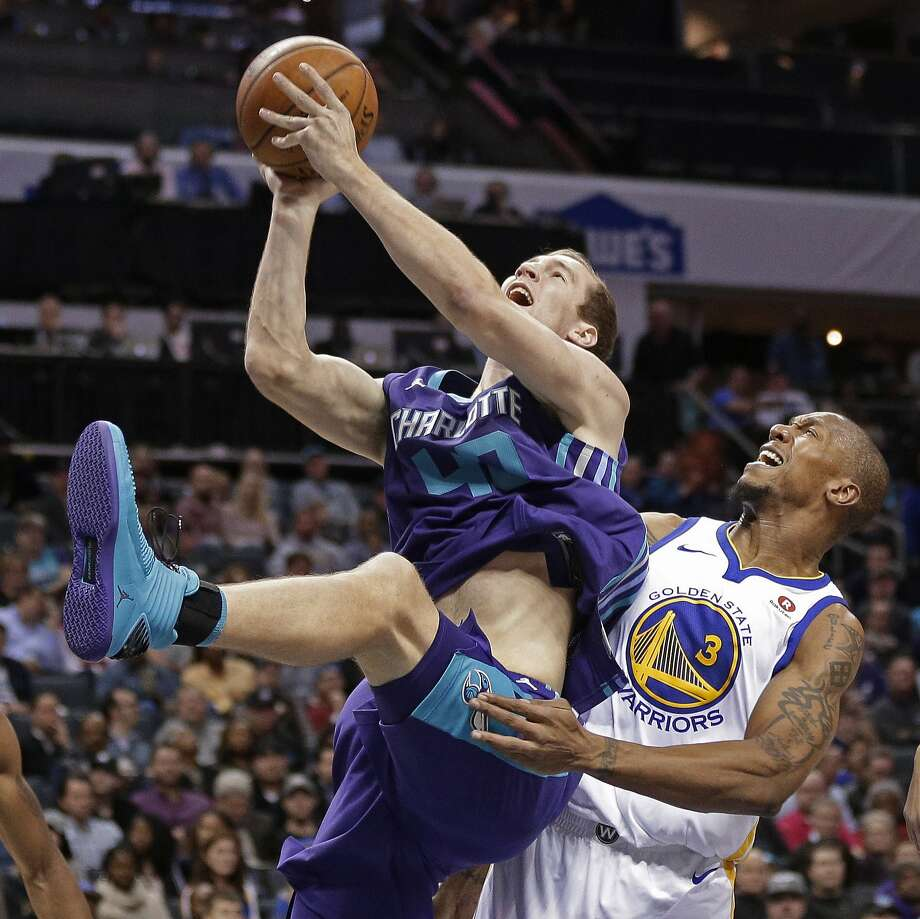 Charlotte Hornets' Cody Zeller (40) is fouled by Golden State Warriors' David West (3) during the first half of an NBA basketball game in Charlotte, N.C., Wednesday, Dec. 6, 2017.  Photo: Chuck Burton, Associated Press