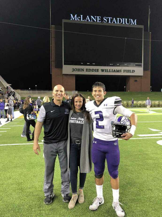 Ezekiel Coss celebrates with his parents Joe and Ronnie after a victory over Coppell at Baylor's McLane Stadium. Former Alexander QB Ezekiel Coss has led Cedar Ridge to the Elite Eight of the Texas high school football playoffs in his senior season after transferring two years ago. Photo: Courtesy Photo