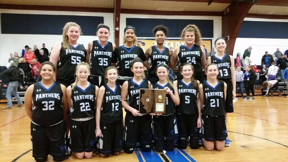 The Liberty Middle School girls' basketball team celebrates with the Sectional 8 championship plaque after defeating Bethalto Trimpe.
