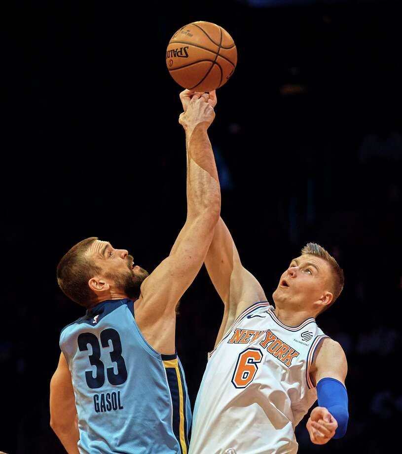 Memphis Grizzlies' Marc Gasol (33) competes for the ball with New York Knicks' Kristaps Porzingis (6) during the first half of an NBA basketball game at Madison Square Garden in New York, Wednesday, Dec. 6, 2017. (AP Photo/Andres Kudacki) ORG XMIT: MSG101 Photo: Andres Kudacki / FR170905 AP