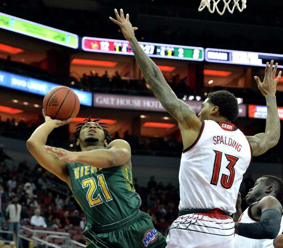 Siena guard Ahsante Shivers (21) attempts a shot over Louisville forward Ray Spalding (13) during the first half of an NCAA college basketball game, Wednesday, Dec. 6, 2017, in Louisville, Ky. (AP Photo/Timothy D. Easley) ORG XMIT: KYTE103 Photo: Timothy D. Easley / FR43398 AP