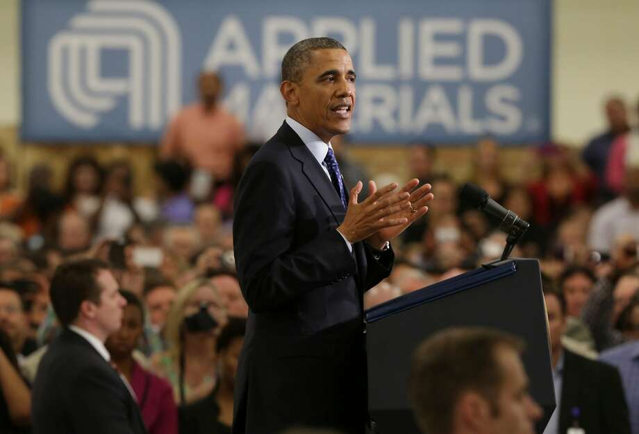 President Barack Obama visits an Austin plant of Applied Materials in 2013. Four former executives at the maker of semiconductor equipment face charges of stealing trade secrets. Photo: Bob Owen, San Antonio Express-News