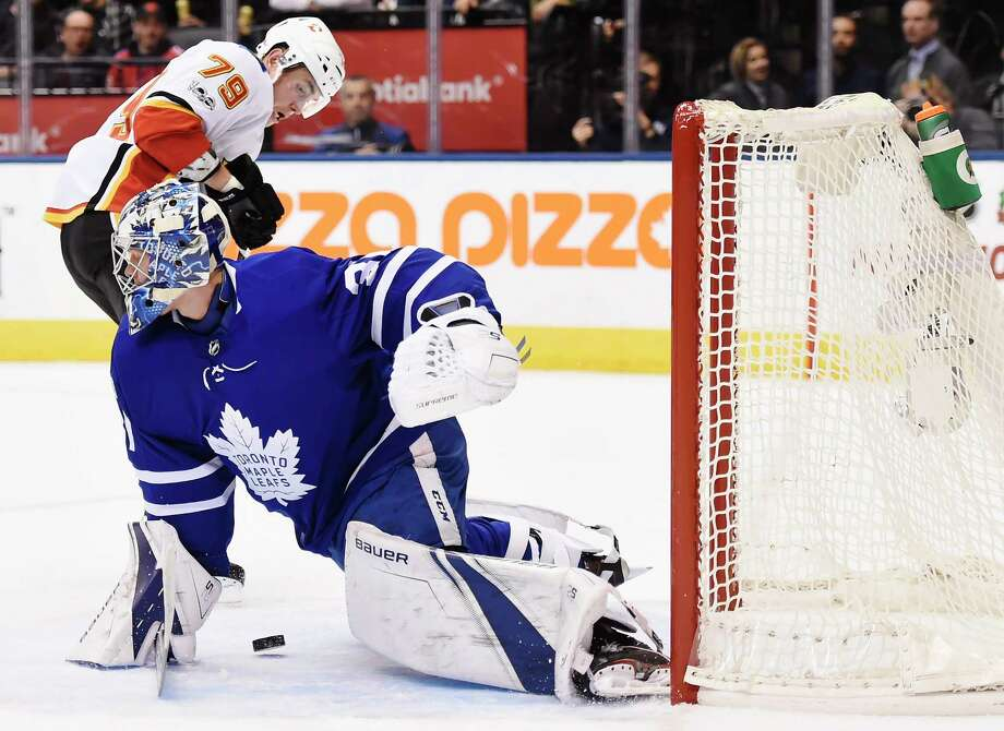 Toronto Maple Leafs goalie Frederik Andersen (31) makes a save on Calgary Flames left wing Micheal Ferland (79) during the first period of an NHL hockey game, Wednesday, Dec. 6, 2017 in Toronto. (Nathan Denette/The Canadian Press via AP) ORG XMIT: NSD508 Photo: Nathan Denette / The Canadian Press