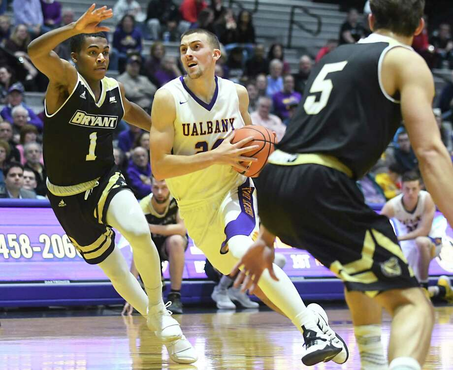 University at Albany's Joe Cremo drives to the hoop during a basketball game against Bryant at the SEFCU Arena on Wednesday, Dec. 6, 2017 in Albany, N.Y. (Lori Van Buren / Times Union) Photo: Lori Van Buren / 20042311A