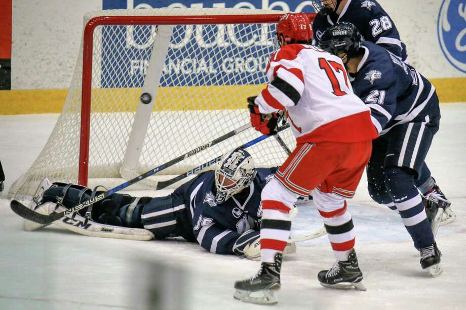 The 2nd of 2 goals Goalie Daniel Tirone #35 of the New Hampshire Wildcats gave up in the 1st period against the Rensselaer Engineers on 12.06.17 at the Houston Field House, Troy NY. Photo: Robert Dungan (Special to the Times Union) ORG XMIT: MER2017082023255053 Photo: Robert Dungan / Robert Dungan 2017