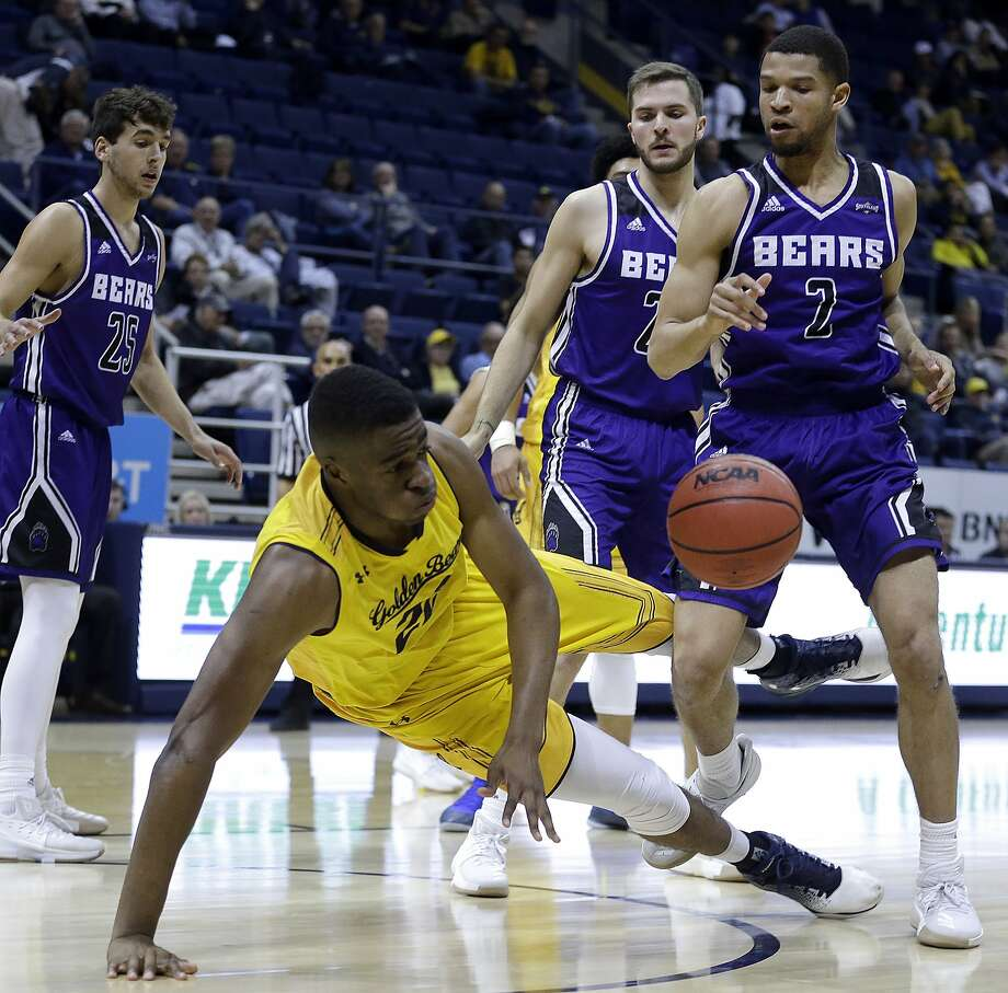California's Kingsley Okoroh falls in front of Central Arkansas' Ethan Lee (2) and Tanner Schmit, second from right, during the first half of an NCAA college basketball game Wednesday, Dec. 6, 2017, in Berkeley, Calif. (AP Photo/Ben Margot) Photo: Ben Margot, Associated Press