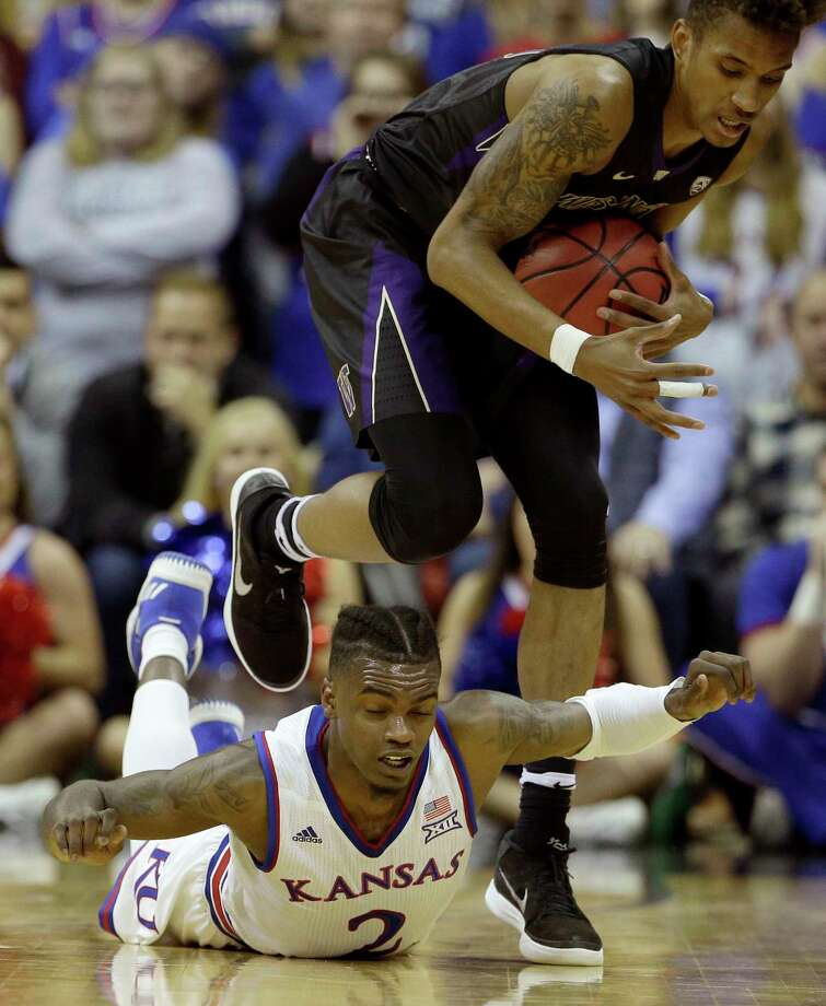 Washington's Hameir Wright beats Kansas' Lagerald Vick (2) to a loose ball during the first half of an NCAA college basketball game Wednesday, Dec. 6, 2017, in Kansas City, Mo. (AP Photo/Charlie Riedel) ORG XMIT: MOCR110 Photo: Charlie Riedel / Copyright 2017 The Associated Press. All rights reserved.
