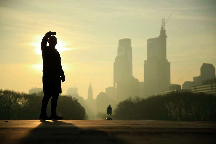A man takes a selfie on the steps of the Philadelphia Museum of Art as the sun rises over Philadelphia, Monday, Dec. 4, 2017. (AP Photo/Matt Rourke) Photo: Matt Rourke, Associated Press / Copyright 2017 The Associated Press. All rights reserved.