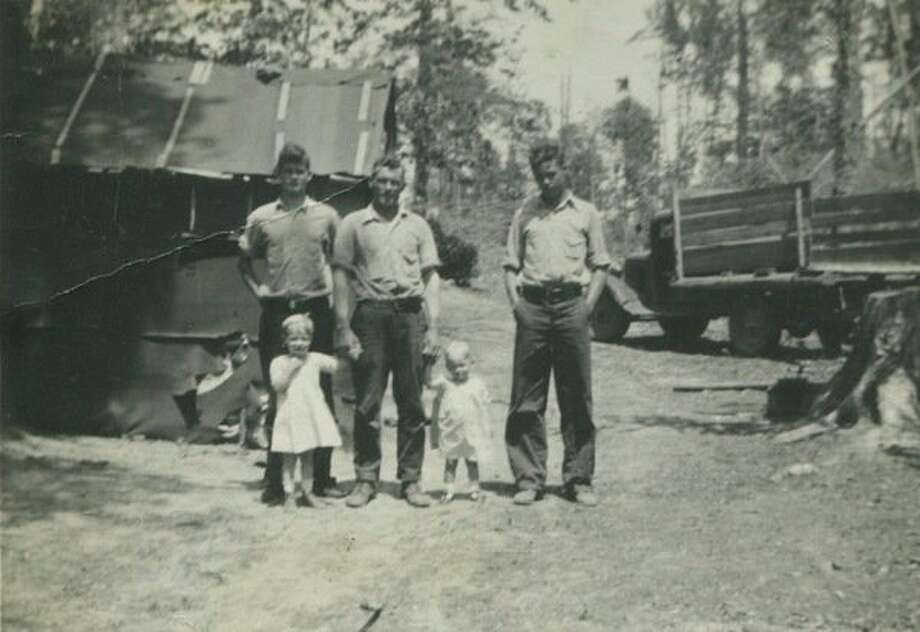 Both sides of Shirley Palmer's family lived in logging camps part of the year and farmed in the summer. From left are Ai Clark, Joseph Stefanski Jr. and Russell Clark. The children are Shirley (on the left) and sister Patricia Stefanski.