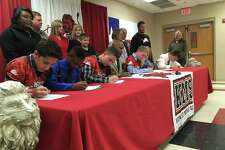 Students at Kountze Middle School, joined by state Rep. James White, signed a pledge to treat women with respect as part of a new program aimed at preventing violence against women.