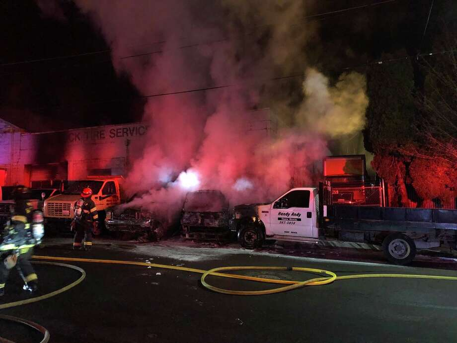 A fire burned several trucks outside Handy Andy Rent-A-Tool on Aurora Avenue in North Seattle Thursday morning. Photo: Seattle Fire