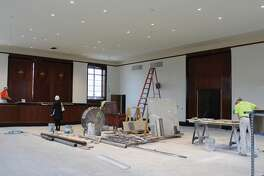 A crew works on the interior of Soldiers Memorial Military Museum in St. Louis.