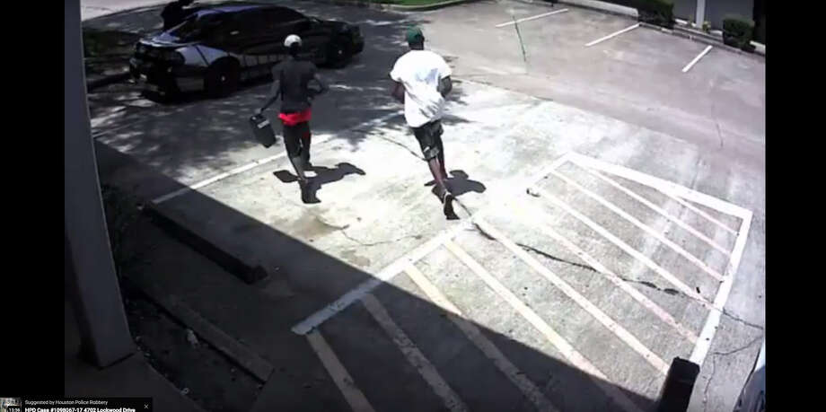 Houston police are searching for three men who robbed a medical clinic on 11000 South Wilcrest Aug. 15.Swipe through to see how the crime unfolded.  Photo: Houston Police Department