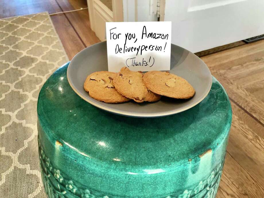 Amazon's delivery people are all business. When we left cookies and a sign, shown here, they didn't bite. Photo: Washington Post Photo By Geoffrey A. Fowler / The Washington Post