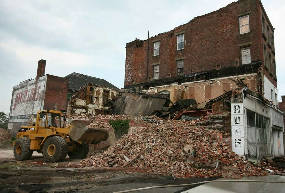 Demolition is underway at 1238-1260 Main Street in downtown Bridgeport. The building were damaged during last Thursday's violent storm. Photo: Brian A. Pounds / Connecticut Post