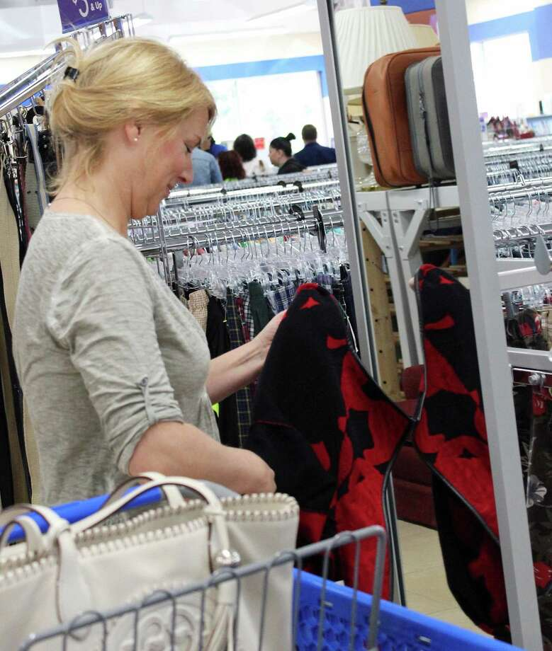 Ashley Noonan tries on a jacket at the new Goodwill Store on Kings Highway East in Fairfield. Fairfield,CT. 12/1/17 Photo: Genevieve Reilly / Hearst Connecticut Media / Fairfield Citizen