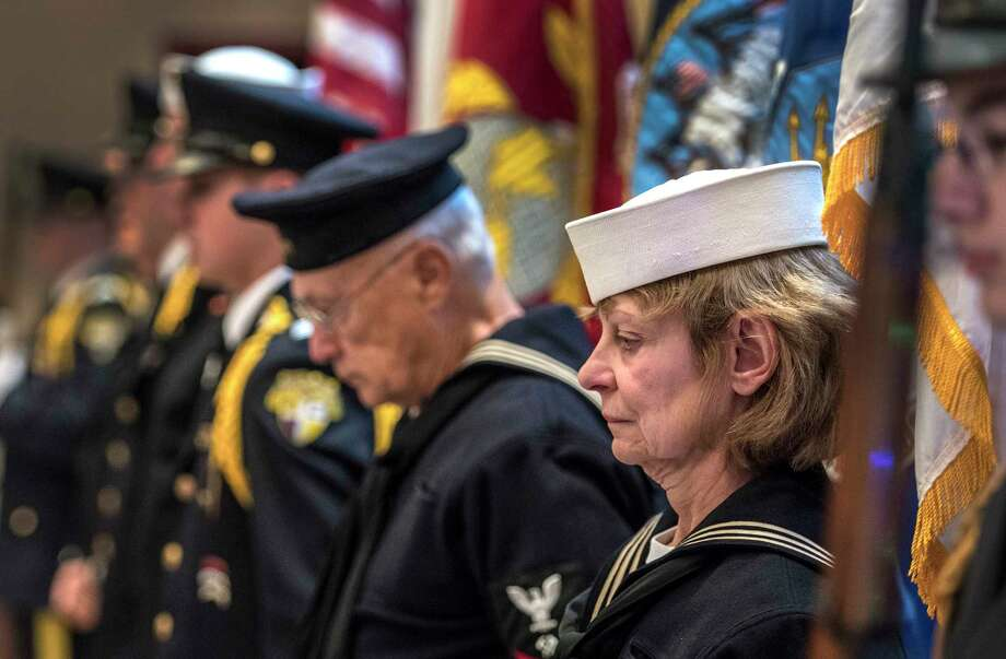 Members of the USS Slater and Christian Brother's Academy Color Guard bring the American Flag bow their heads during a prayer at the Pearl Harbor Day Memorial Observance held at the J.E. Zaloga Post of the American Legion Thursday Dec 7, 2017 in Albany, NY.   (Skip Dickstein/ Times Union) Photo: SKIP DICKSTEIN, Albany Times Union / 20042339A
