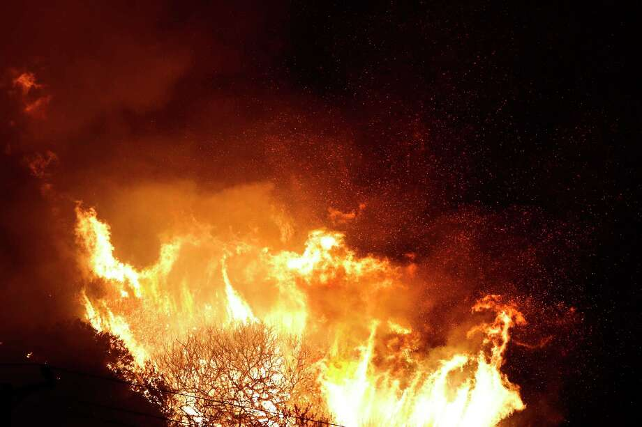 A wildfire flares up as it burns along a hillside toward homes in La Conchita, Calif., Thursday, Dec. 7, 2017. The wind-swept blazes have forced tens of thousands of evacuations and destroyed dozens of homes. Photo: Jae C. Hong, AP / Copyright 2017 The Associated Press. All rights reserved.