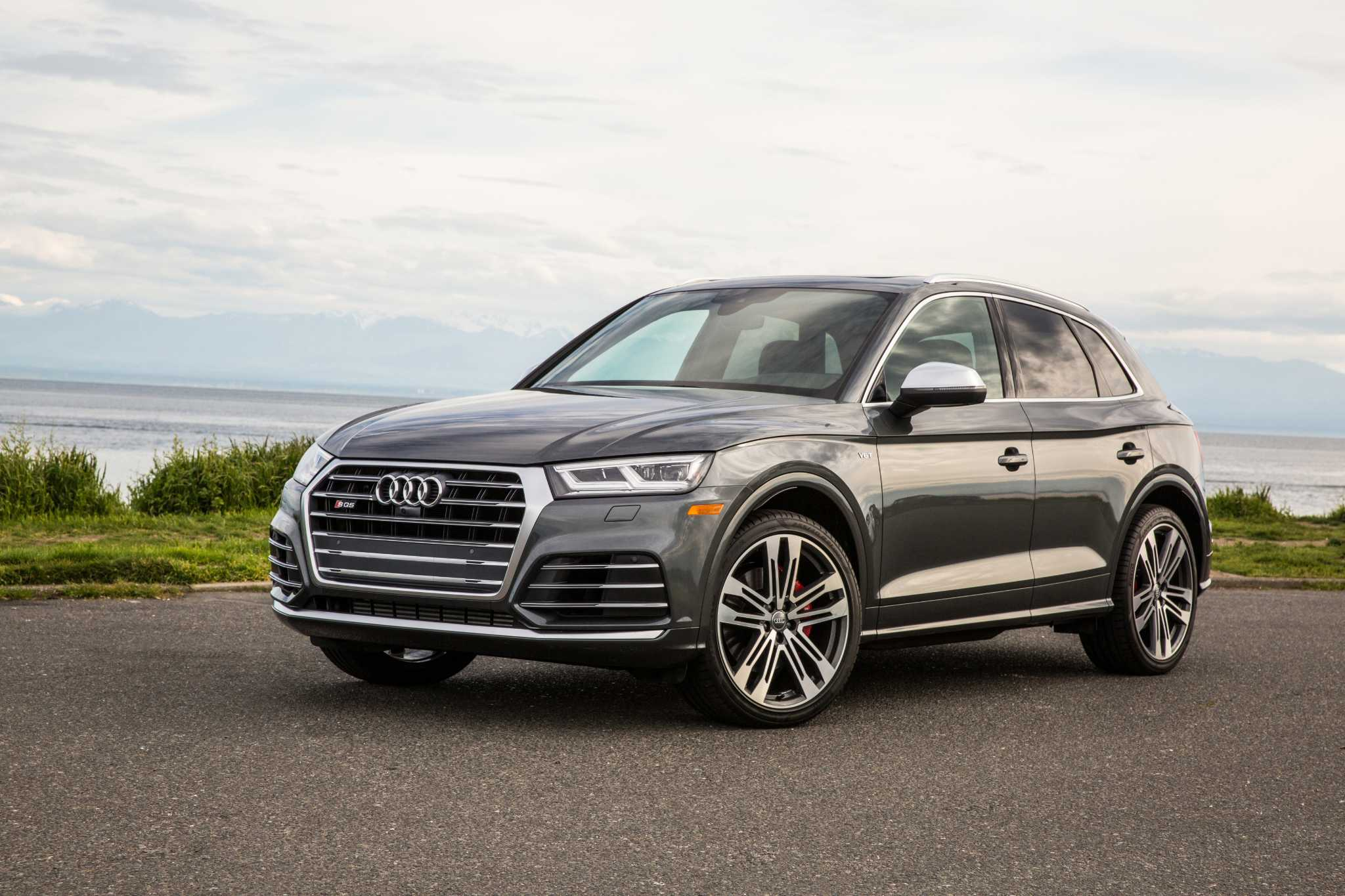 A Blue Sky Audi Suv With A Price Way Up Yonder