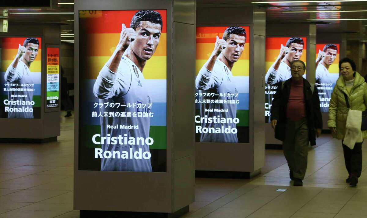 Images of Real Madrid's Cristiano Ronaldo are displayed for TV promotion of upcoming soccer Club World Cup in Tokyo, Saturday, Dec. 2, 2017. Various confederation champions meet in the United Arab Emirates for the Club World Cup, which will start on Dec. 6. (AP Photo/Koji Sasahara)