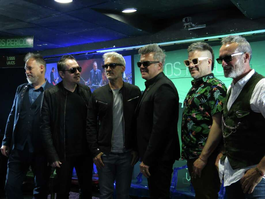 "In this Oct. 24, 2017 photo, members of the Argentine band Los Pericos pose for photos during a press conference to promote their 30th anniversary album ""3,000 Vivos"" in Mexico City. From left are Ariel ""Topo"" Raiman, Willie Valentinis, Diego Blanco, Juanchi Baleiron, Gaston Goncalvez and Marcelo Blanco. (AP Photo/Berenice Bautista) Photo: Berenice Bautista, STF / AP"