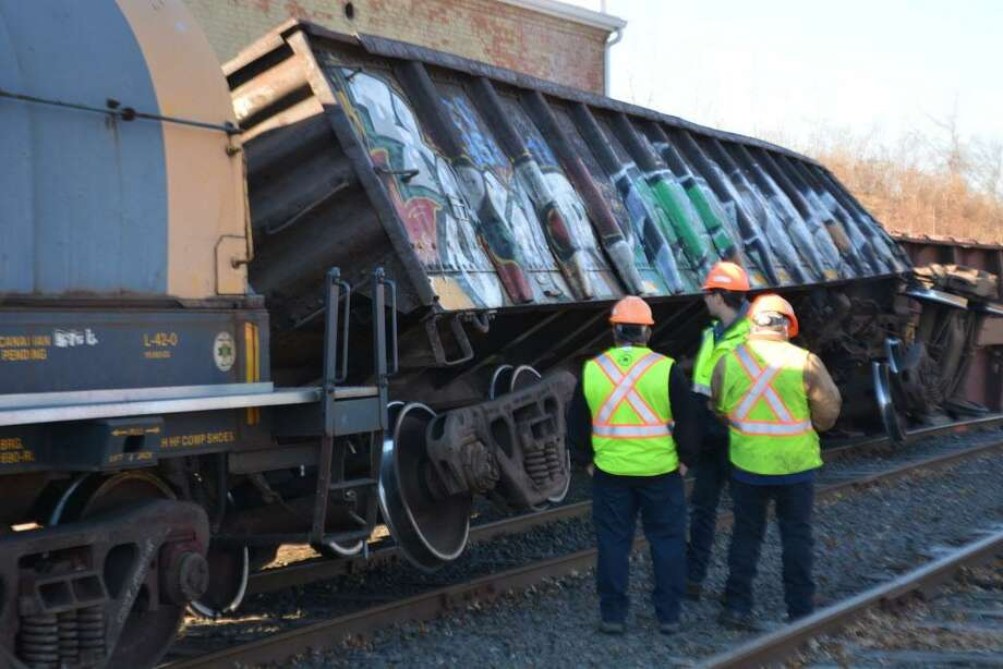 More than a half-dozen Providence & Worcester train cars went off the tracks some time overnight Wednesday near the transfer station on Johnson Street in the city's North End. No one was hurt, police said. Photo: Cassandra Day / Hearst Connecticut Media