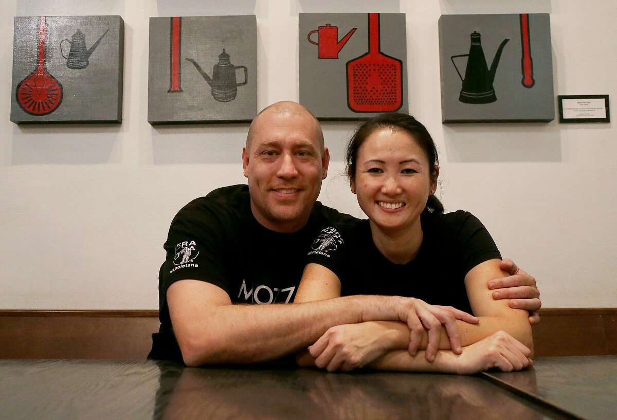 In this Nov. 5, 2015 photo, Mozzeria owners Russ and Melody Stein pose for a photo at their restaurant in San Francisco. The Steins and Mozzeria staff workers are deaf. The Steins have run their restaurant since 2011. (AP Photo/Jeff Chiu)