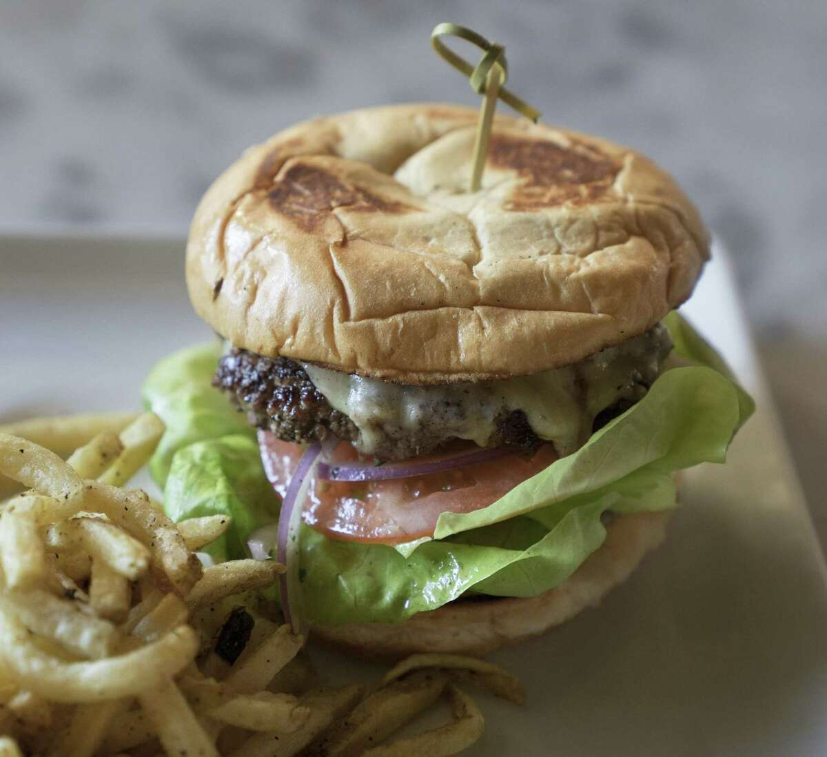 Rosella at The Rand's Classic Burger with fries includes cheese, Bibb lettuce and tomatoes.
