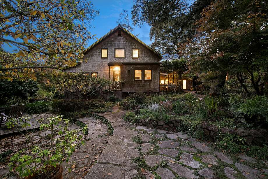 Stone pathways meander beside the Inverness home. Photo: Open Homes Photography