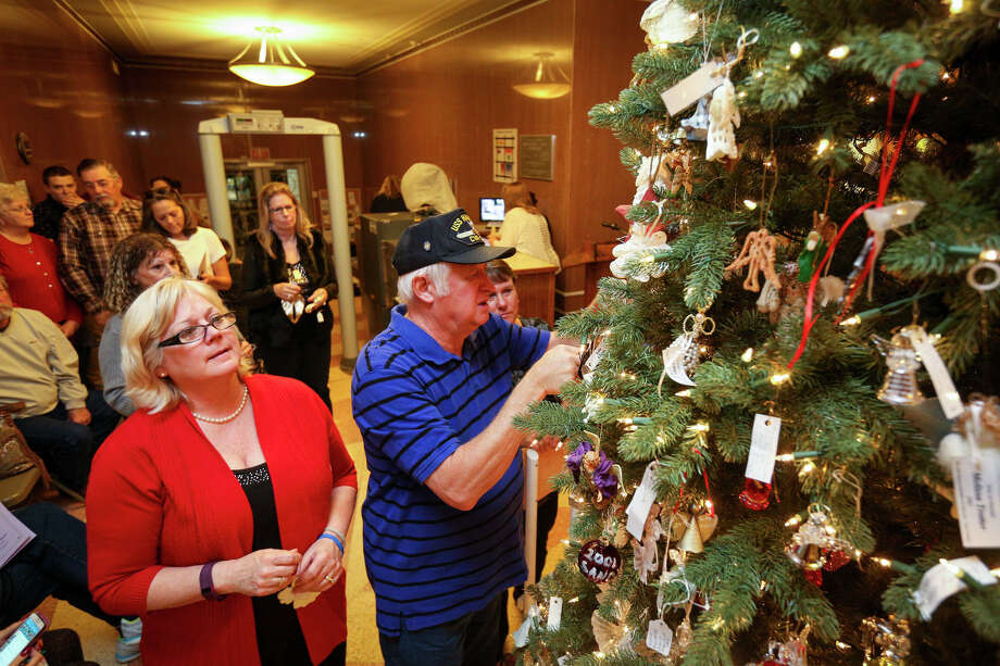 Family and friends of victims hang angels on the Tree of Angels during a ceremony on Tuesday, Dec. 6, 2016, at the Montgomery County Courthouse. Photo: Michael Minasi, Staff / © 2016 Houston Chronicle