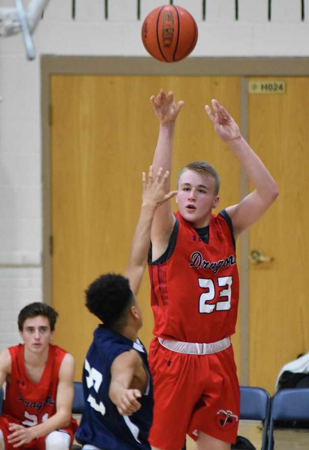 Greens Farms Academy's Max Mitchell puts up a shot over Redemption Christian Academy during their season-opening contest last Friday . The Dragons won 71-62. Photo: Contributed Photo