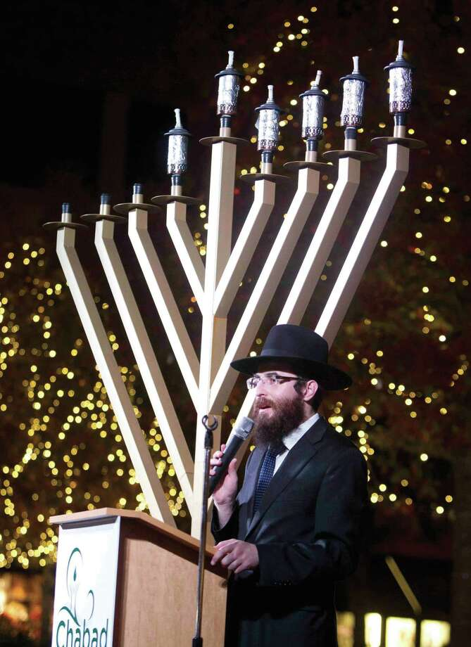 Rabbi Mendel Blecher, with Chabad of The Woodlands, addresses worshipers during a menorah lighting ceremony in 2015. Photo: Jason Fochtman / Internal