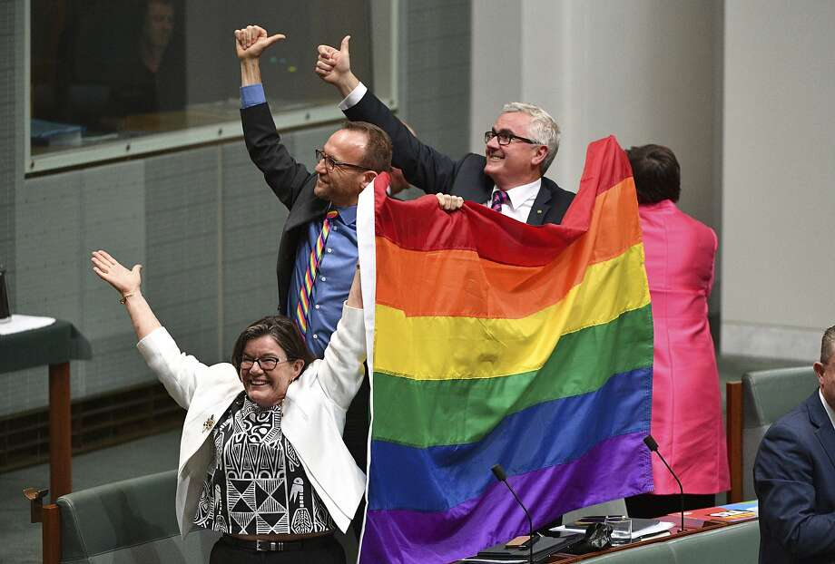 Members of parliament celebrate the passing of the Marriage Amendment Bill in the House of Representatives at Parliament House in Canberra. The Senate passed the legislation last week. Photo: Mick Tsikas, Associated Press