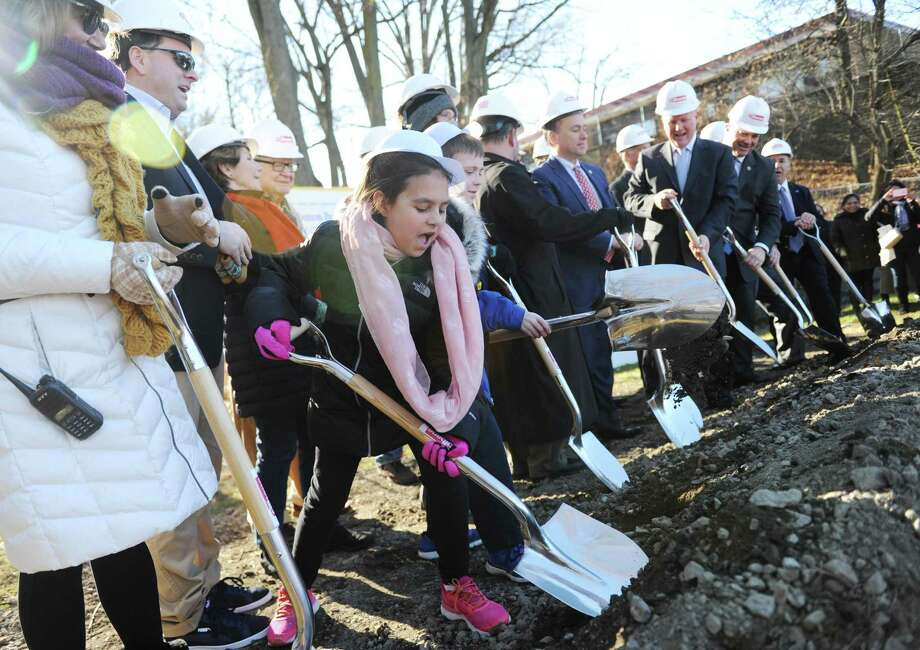 Fifth-grader Layla Rodriguez and others participate in the New Lebanon School groundbreaking ceremony Thursday. Photo: Tyler Sizemore / Hearst Connecticut Media / Greenwich Time