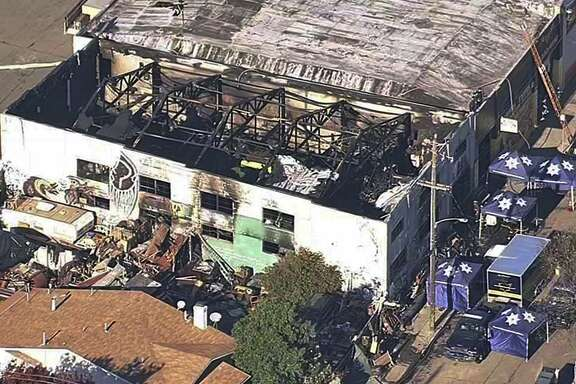 FILE- This Dec. 3, 2016, file image from video provided by KGO-TV shows the Ghost Ship Warehouse after a fire swept through the building in Oakland, Calif. Prosecutors are trying to persuade Alameda County Judge Jeffrey Horner that Derick Almena and Max Harris should stand trial on involuntary manslaughter charges in connection with the Oakland, Calif., warehouse fire that would become the site of the country's deadliest building fire in more than a decade.  (KGO-TV via AP, File)