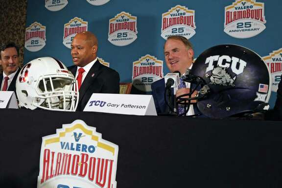 David Shaw,head coach of Stanford, left, , and Gary Patterson head coach at TCU answers questions at the Valero Alamo Bowl head coaches press conference at Sonterra on Thursday, Dec. 7, 2017.