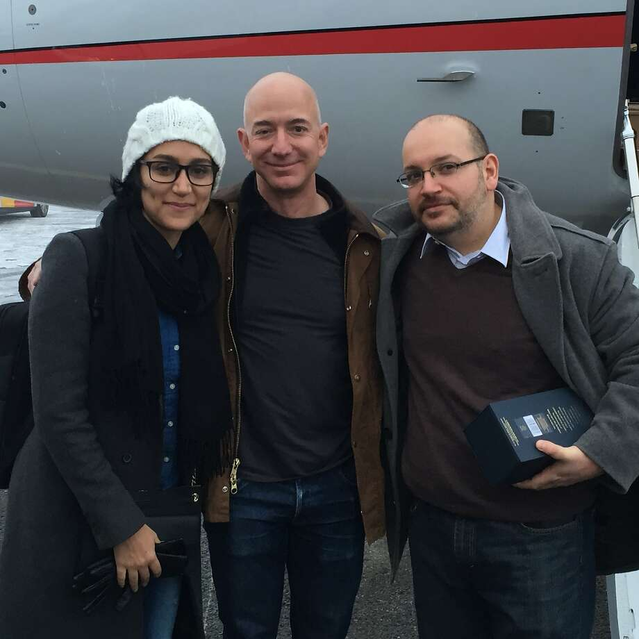 A 2016 photo released by the Washington Post shows Jason Rezaian and his wife, Yeganeh Salehi, with Post owner Jeff Bezos in Saarbruecken, Germany, before taking off for a return journey to the U.S. The nonprofit Reporters Without Borders worked to free Rezaian. Bezos is now making a gift to the organization to open a San Francisco operation. Photo: DOUGLAS JEHL, AFP / Getty Images