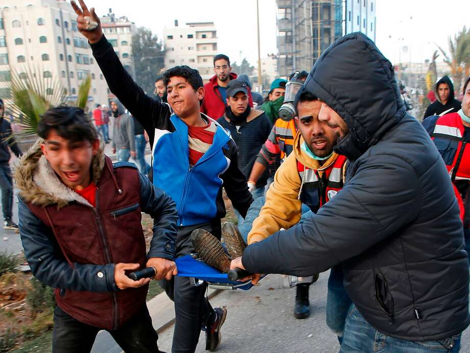 Palestinian protesters evacuate a wounded demonstrator during clashes with Israeli troops near the West Bank city of Ramallah. Photo: ABBAS MOMANI, AFP/Getty Images