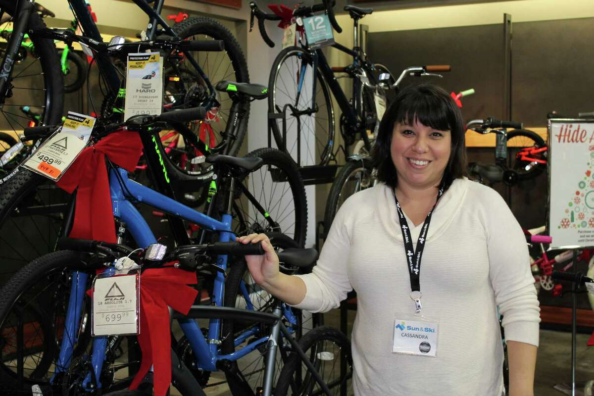 Sun & Ski general manger Cassandra Cribley stands beside a bicycle display rack at a newly opened pop up location at Market Street. Sun & Ski is a Houston-based retail store that specializes in outdoor equipment, apparel and footwear.