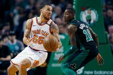 Phoenix Suns' Mike James (55) pivots beside Boston Celtics' Terry Rozier (12) during the fourth quarter of an NBA basketball game in Boston, Saturday, Dec. 2, 2017. The Celtics won 116-111. (AP Photo/Michael Dwyer)