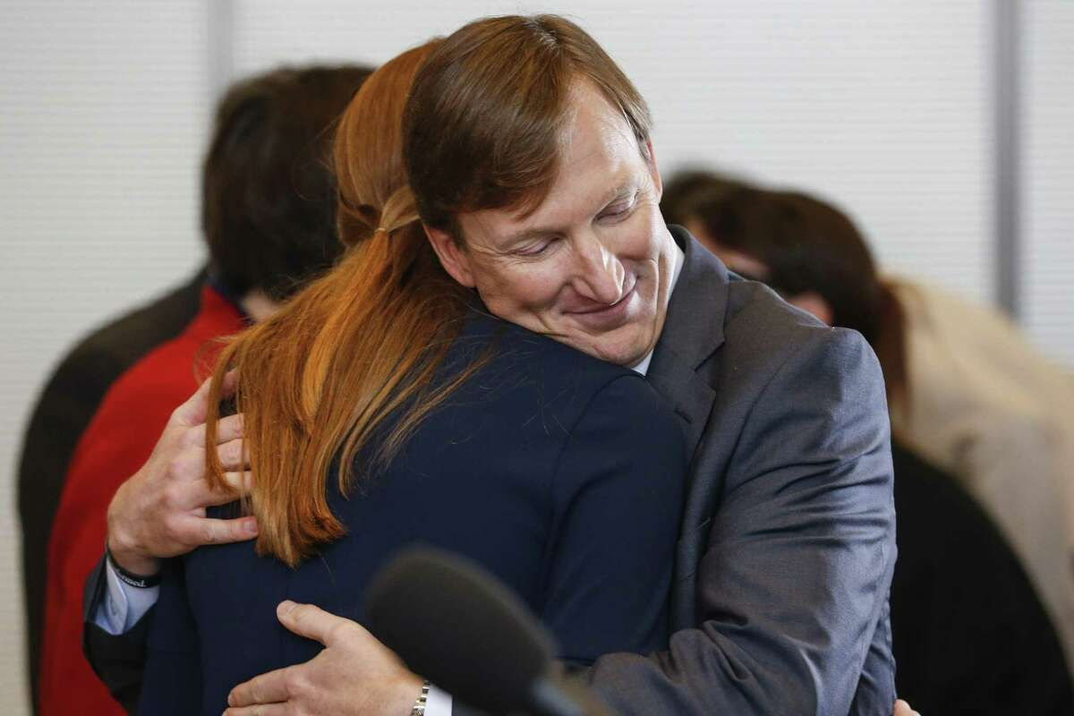 Andrew White, son of former Texas Governor Mark White, gets a hug from his daughter as he launches his campaign for Governor Thursday, Dec. 7, 2017 in Houston.( Michael Ciaglo / Houston Chronicle)