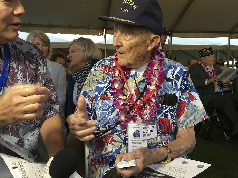 Pearl Harbor survivor Gilbert Meyer, 94, speaks to a reporter before a remembrance ceremony at Pearl Harbor, Hawaii. He returned because of his shipmates from the battleship Utah. Photo: Audrey McAvoy, Associated Press