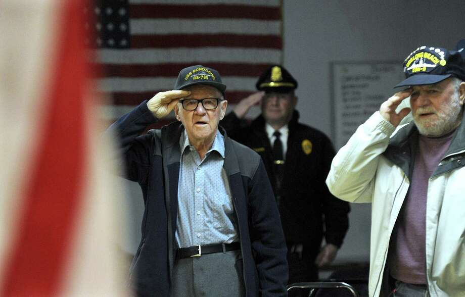 Paul Hulton, 91, left, turned 15 the day the Japanese bombed Pearl Harbor. Thursday, Dec. 7, 2017, the VFW Post 1672 and American Legion Ezra Woods Post 31 in New Milford held a ceremony to commemorate the day. Right is John Danish, a navy veteran who served during the Cuban Missile Crisis. Photo: Carol Kaliff / Hearst Connecticut Media / The News-Times