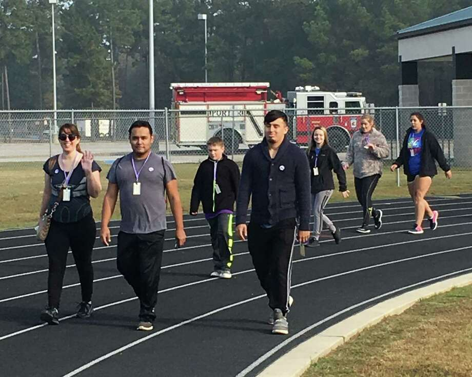 Dozens of local citizens partake in the walk to support research to fight cystic fibrosis, which was held at New Caney ISD's Don Ford stadium on Dec. 2. The walk is referred to as Superheroes Fighting Cystic Fibrosis. Photo: Submitted