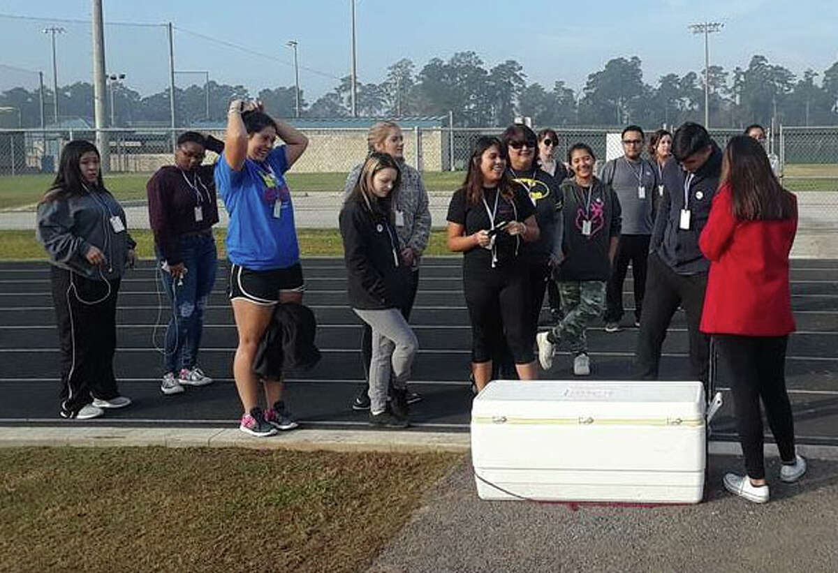 Walkers get prepared to combat cystic fibrosis at the track located in New Caney ISD's Don Ford Stadium.