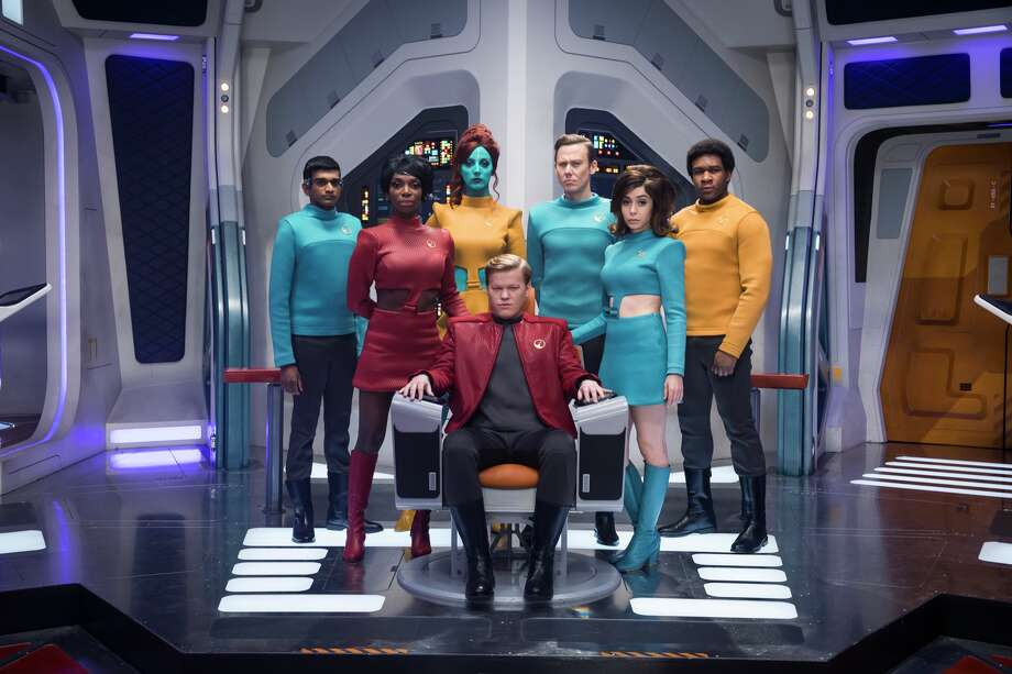 "Jimmi Simpson, Jesse Plemons, Cristin Milloti, among otherss, in a still from season four of Netflix's ""Black Mirror."" Photo: Netflix"